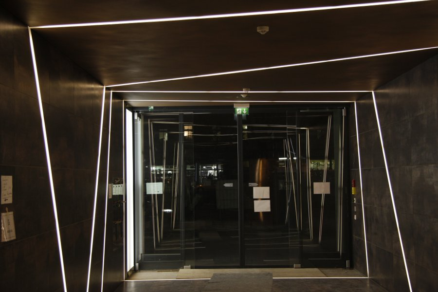 led light lines in a hallway in munich. Black Bedroom Furniture Sets. Home Design Ideas